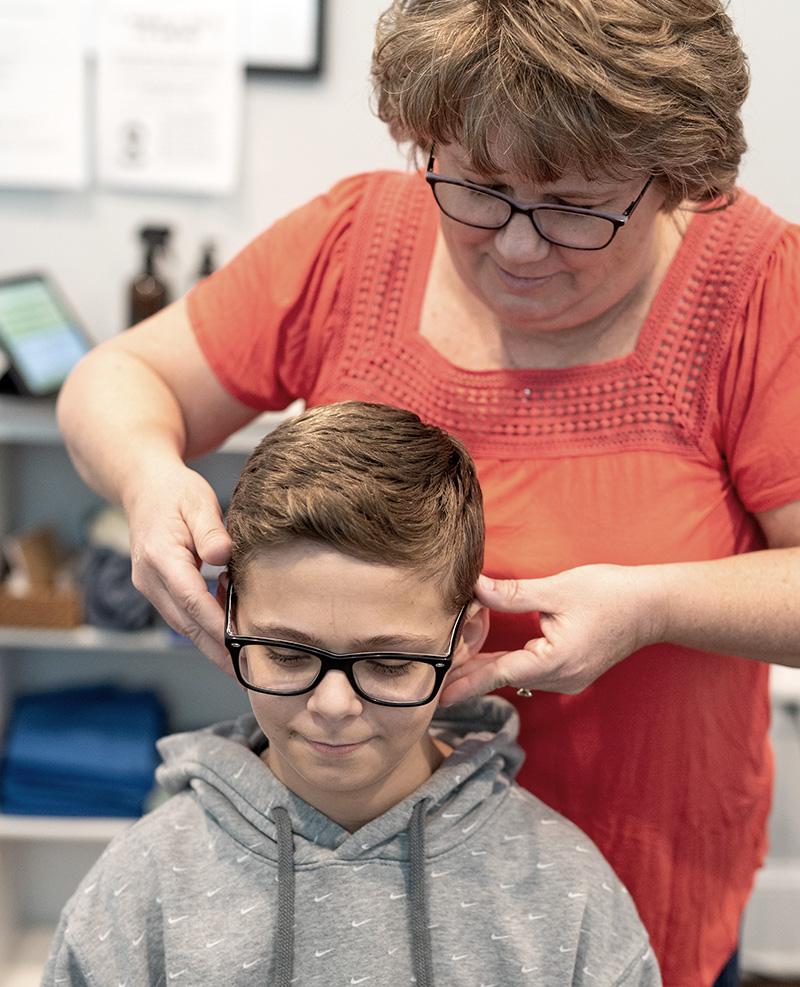 boy receiving chiropractic adjustment