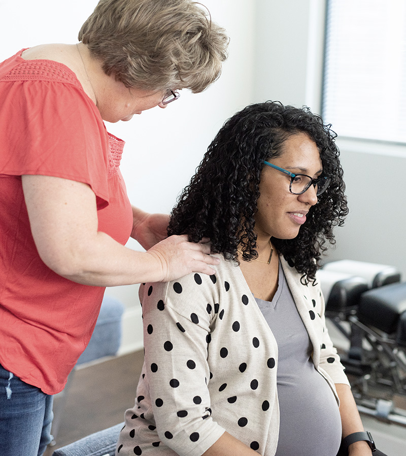 pregnant woman receiving chiropractic care